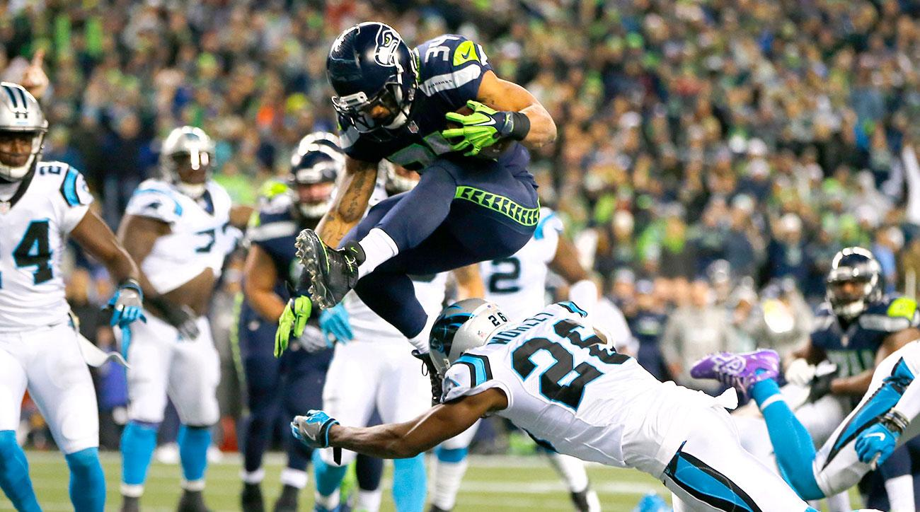 Running back Thomas Rawls #34 of the Seattle Seahawks scores a touchdown against the Carolina Panthers at CenturyLink Field on December 4, 2016 in Seattle, Washington. (Photo by Jonathan Ferrey/Getty Images)
