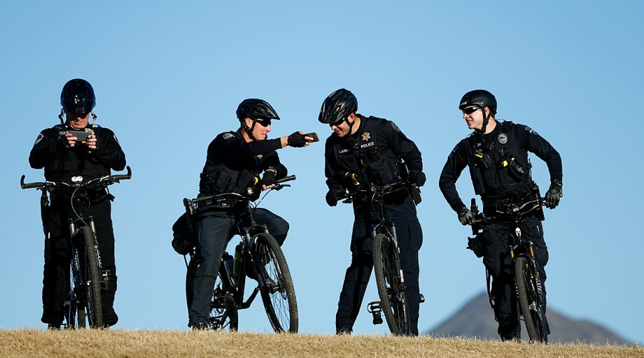 Police patrol the Waste Management Phoenix Open in 2016.