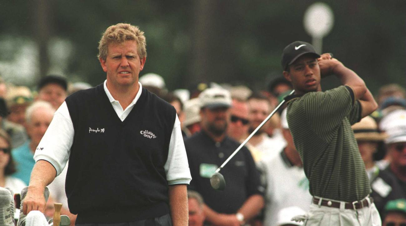 Colin Montgomerie of Scotland stands beside Tiger Woods of the USA as Woods practices on the first tee during the third round of the 1997 Masters