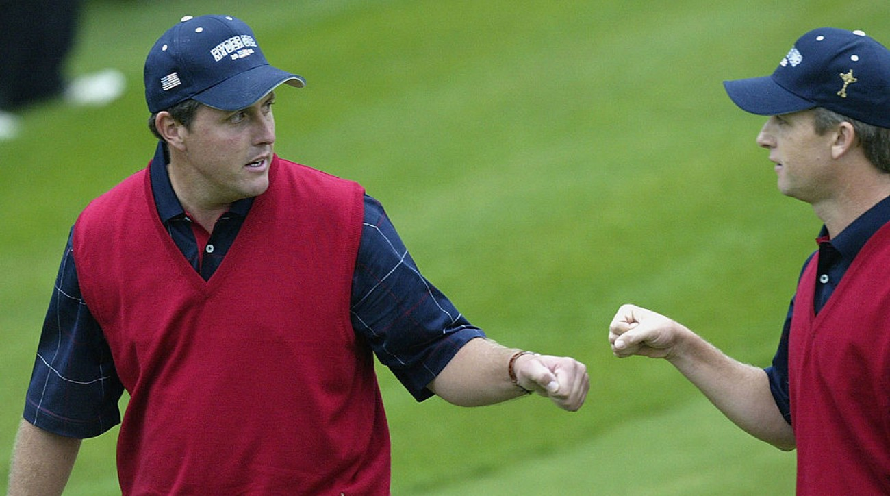Phil Mickelson and David Toms celebrate on the second day of the 2002 Ryder Cup.