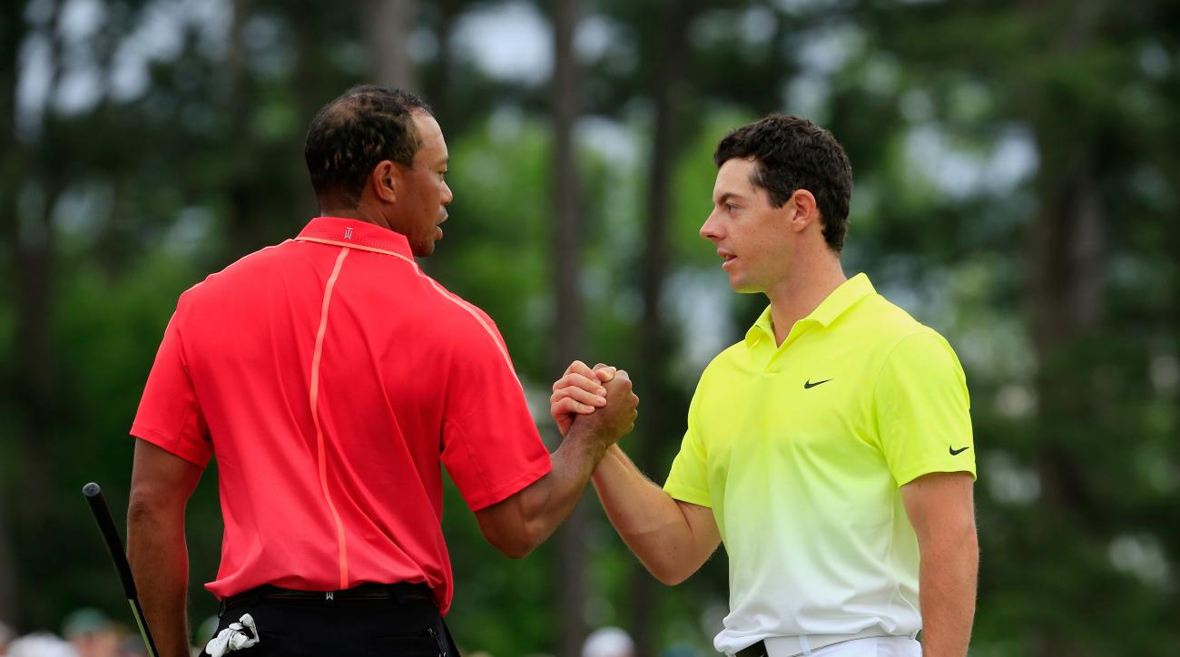 Tiger Woods and Rory McIlroy shake hands on the 18th green during the final round of the 2015 Masters Tournament.