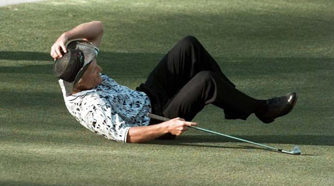 Greg Norman falls to the ground after missing his shot for an eagle on the 15th hole during final round of the 1996 Masters.