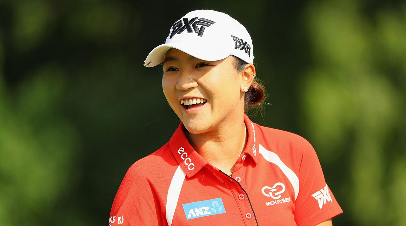 Lydia Ko of New Zealand smiles on the practice range prior to the start of the final round of the 2017 HSBC Women's Champions.