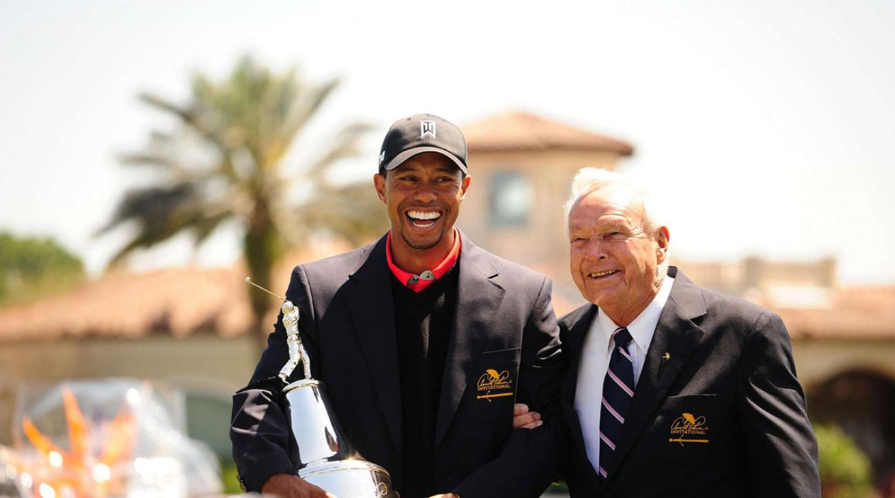 Tiger Woods and Arnold Palmer share a laugh at the trophy ceremony at the 2013 Arnold Palmer Invitational.