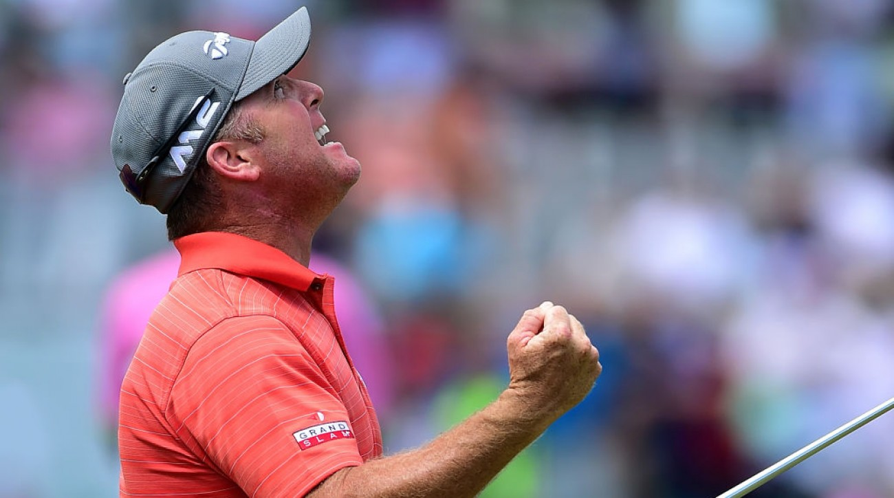 D.A. Points celebrates after making his birdie putt on the 18th green during the final round to win the Puerto Rico Open .