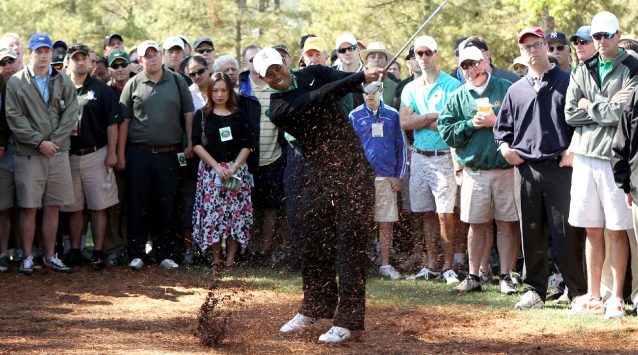 Tiger Woods plays a shot from the pine needles on the first hole during the second round of the 2010 Masters.