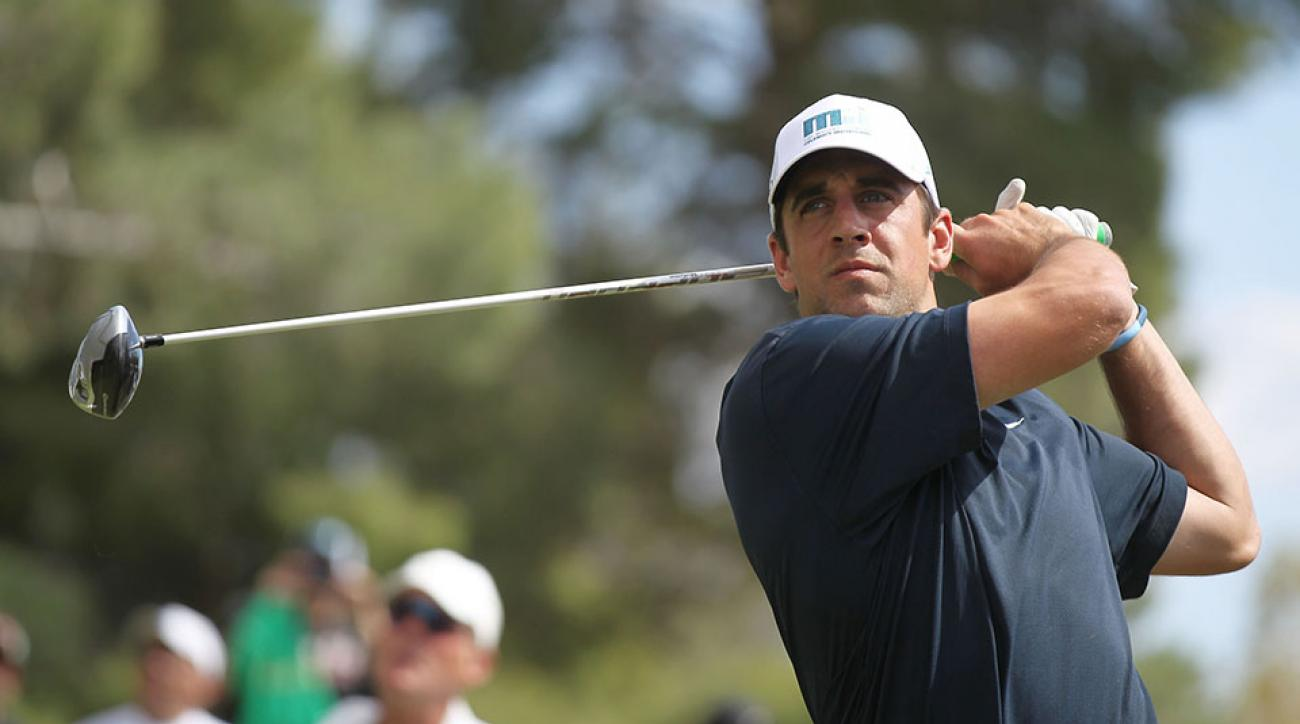 Aaron Rodgers hits a tee shot during Aria Resort & Casino's 13th Annual Michael Jordan Celebrity Invitational at Shadow Creek on April 5, 2014.