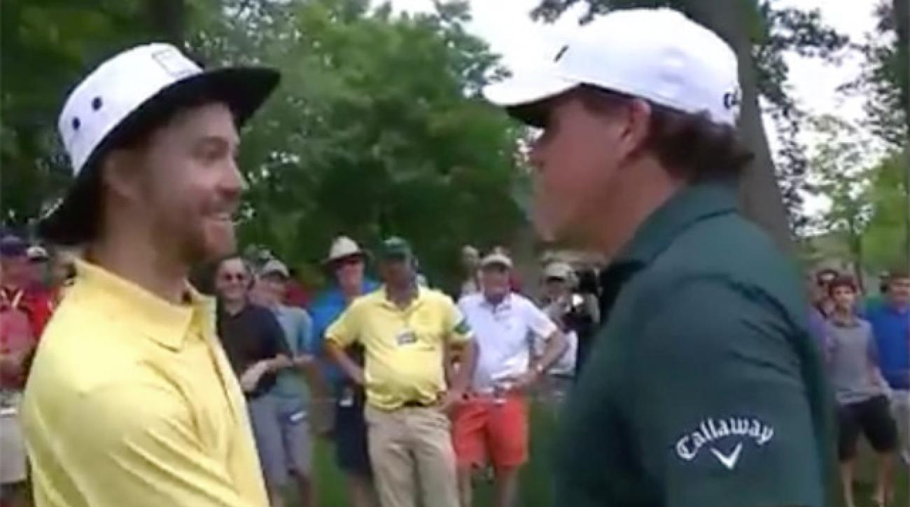 Phil Mickelson greets the man he beaned in the head with a drive.