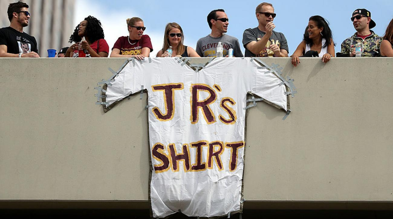 Fans hung a J.R.'s shirt sign up during the Cleveland Cavaliers' victory parade.