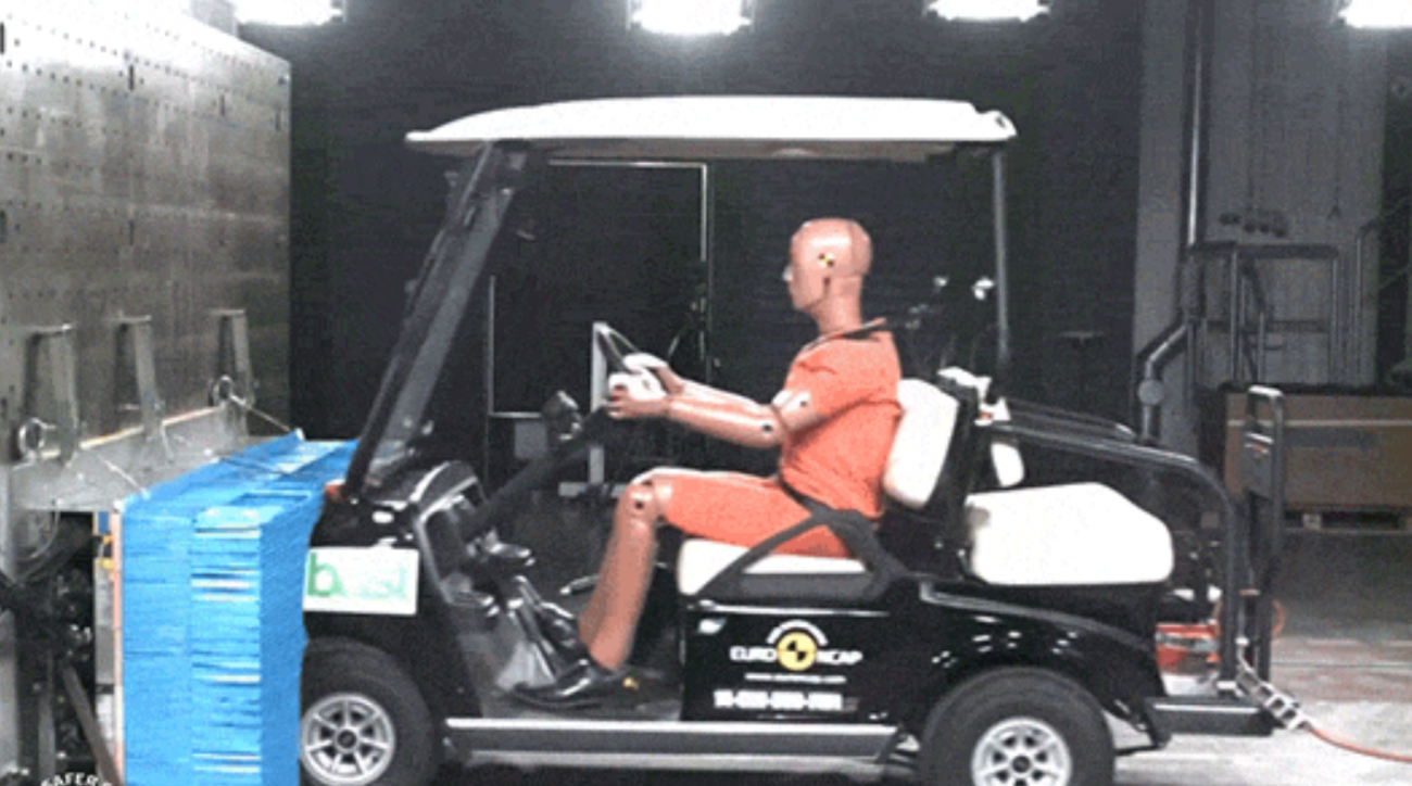 The moment of impact with a golf cart going 30 mph into a wall.