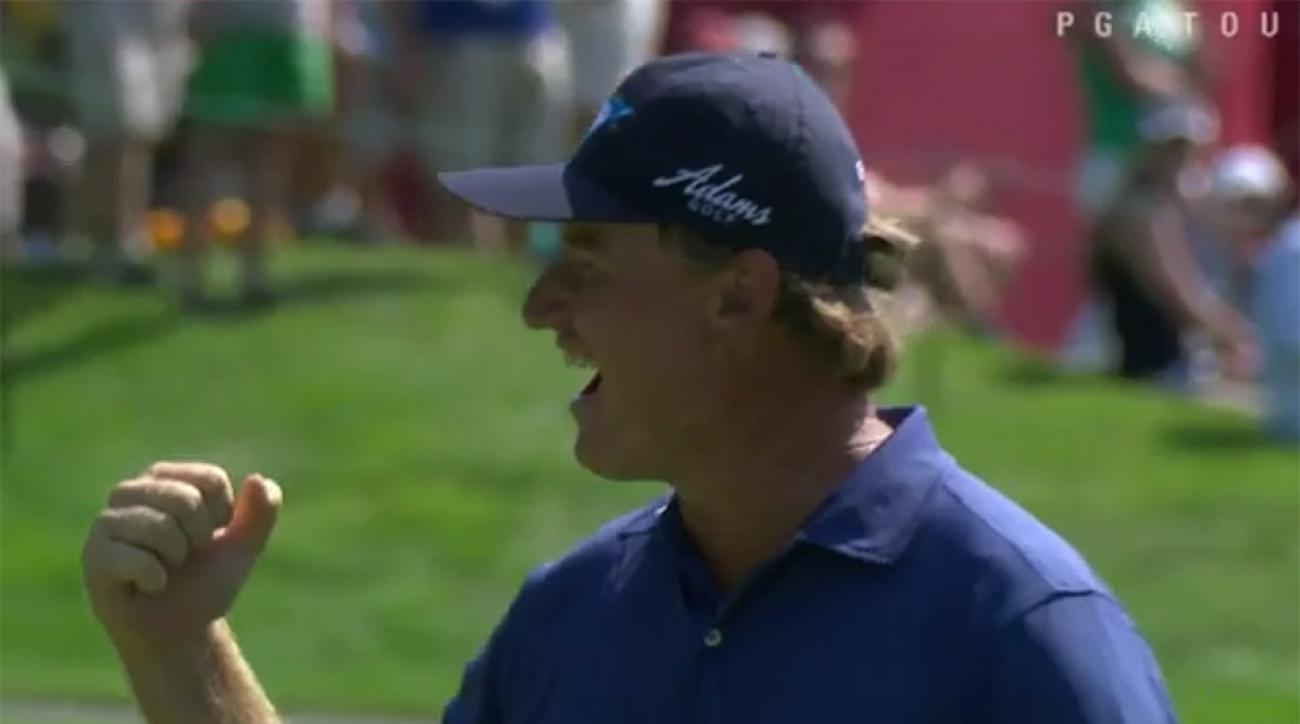 Ernie Els celebrates after making eagle on the par-4 12th hole during Round 3 of the Quicken Loans National.