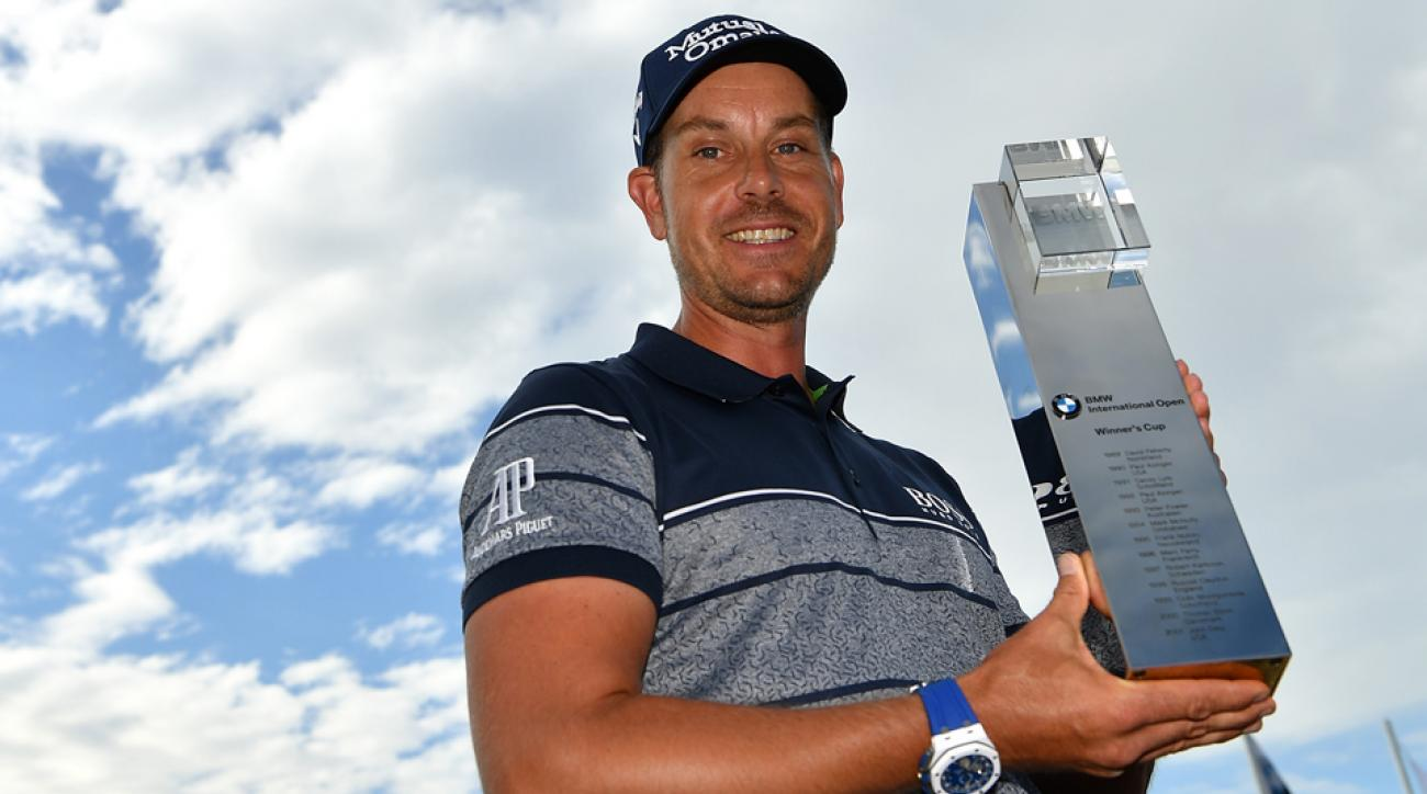 Henrik Stenson of Sweden poses with the trophy following his three-shot victory in the BMW International Open.