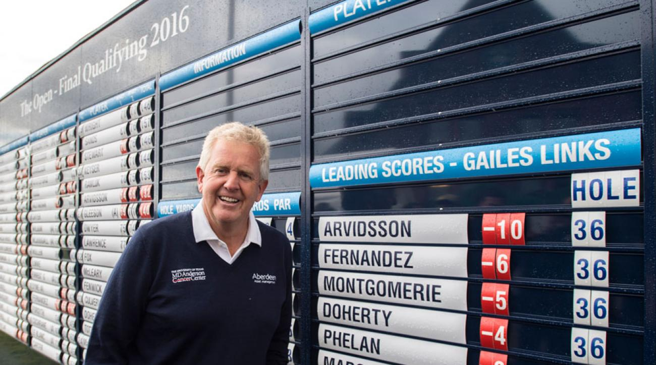 Colin Montgomerie poses next to the leaderboard after taking the third qualifying spot for the 2016 British Open.