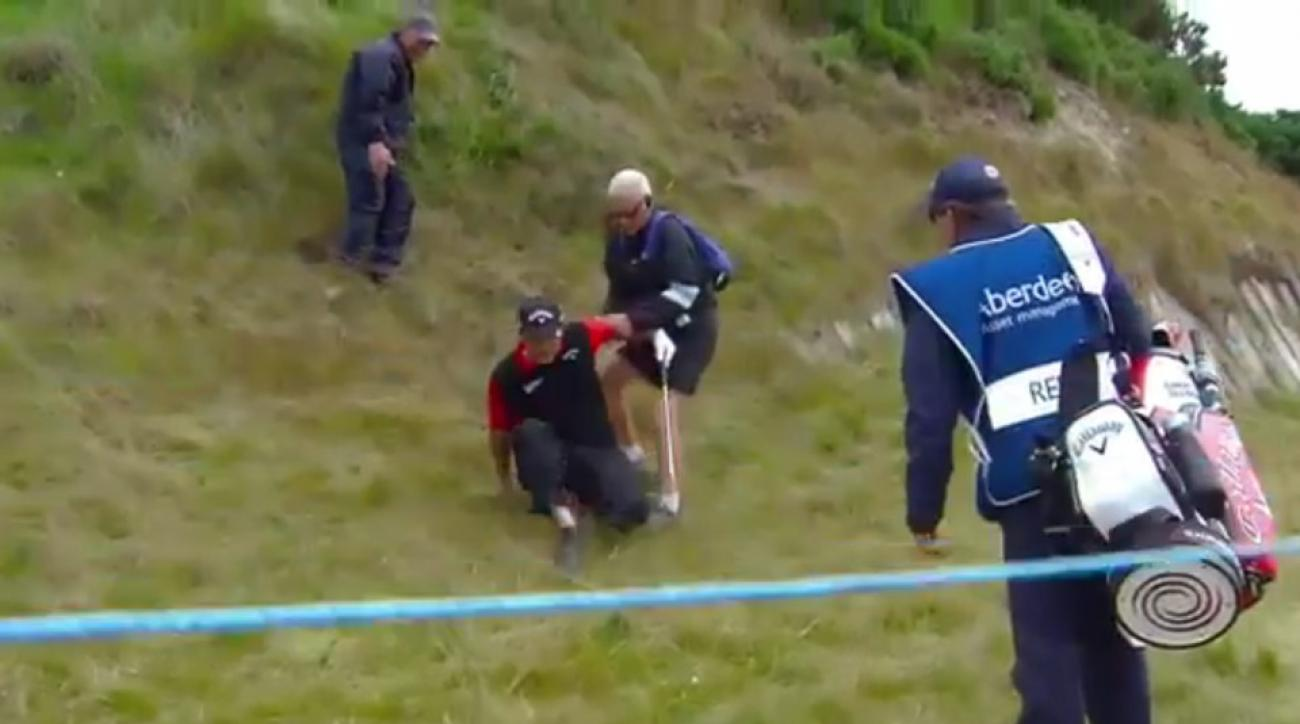 Patrick Reed falling at the Scottish Open on Thursday.