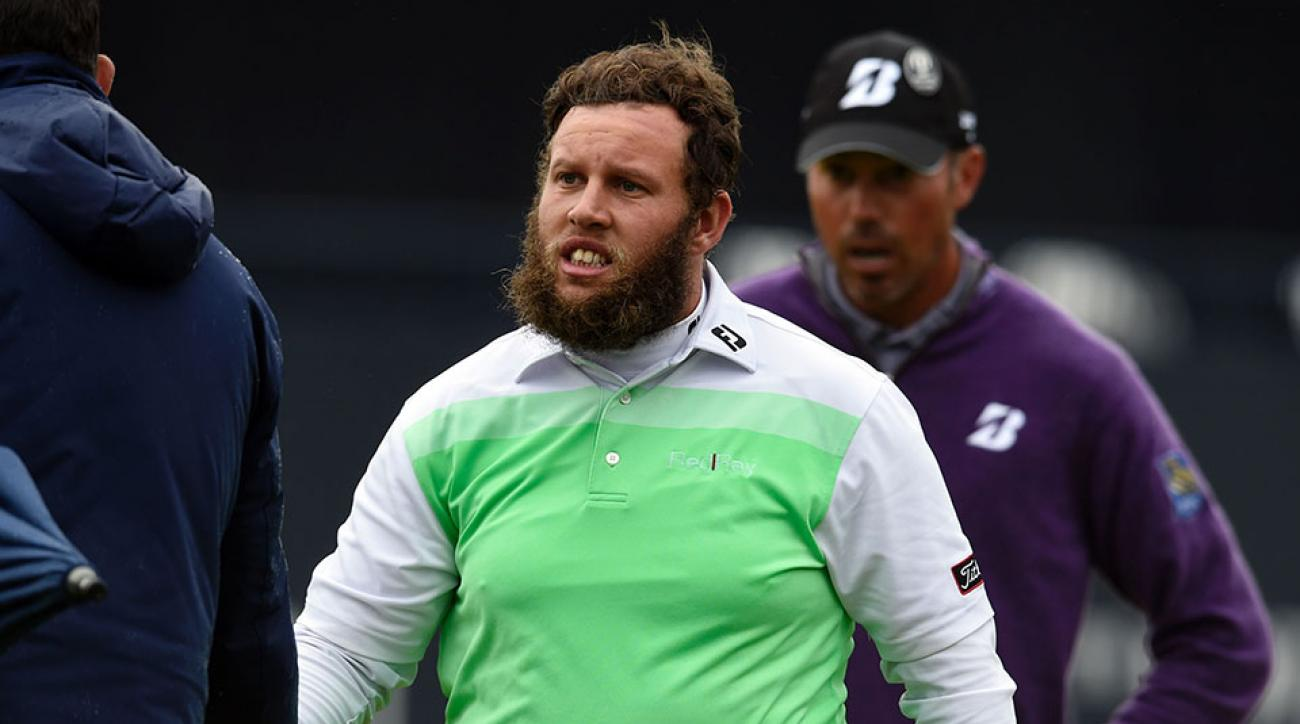 England's Andrew Johnston shakes hands with an official on the 18th green after his second round 69 on day two of the 2016 British Open Golf Championship at Royal Troon in Scotland on July 15, 2016.