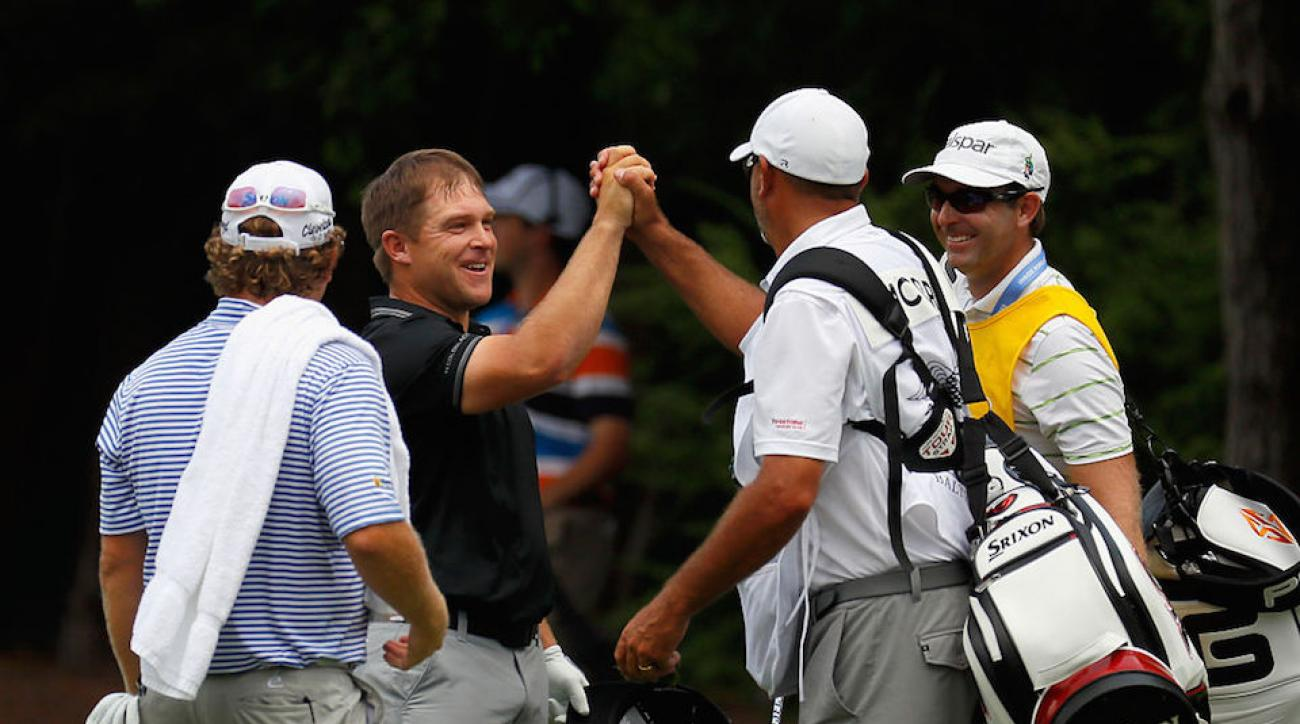 Daniel Summerhays celebrates his eagle with William McGirt and caddies Brandon Antus and Nick Jones.