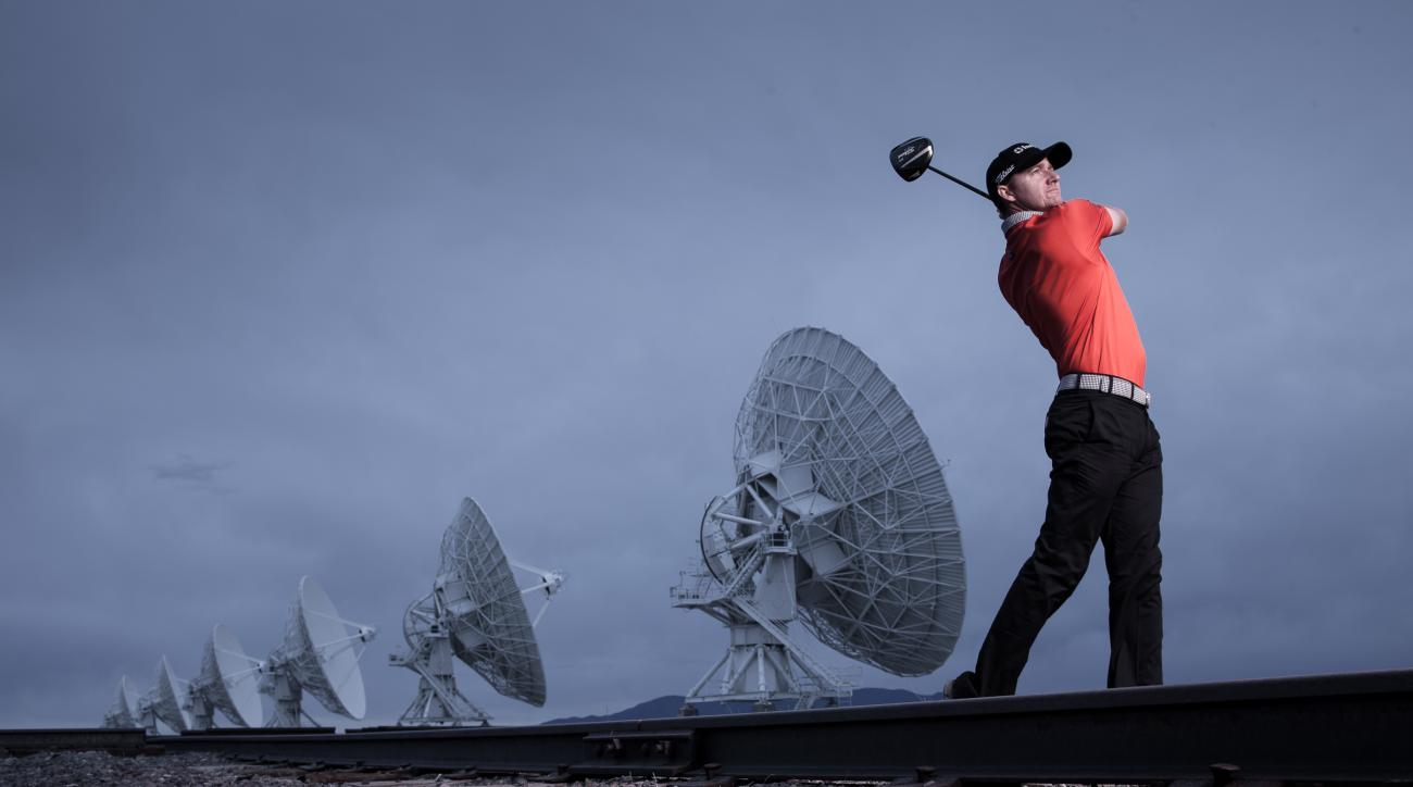Jimmy Walker hits drives into, and takes pictures of, the sky.