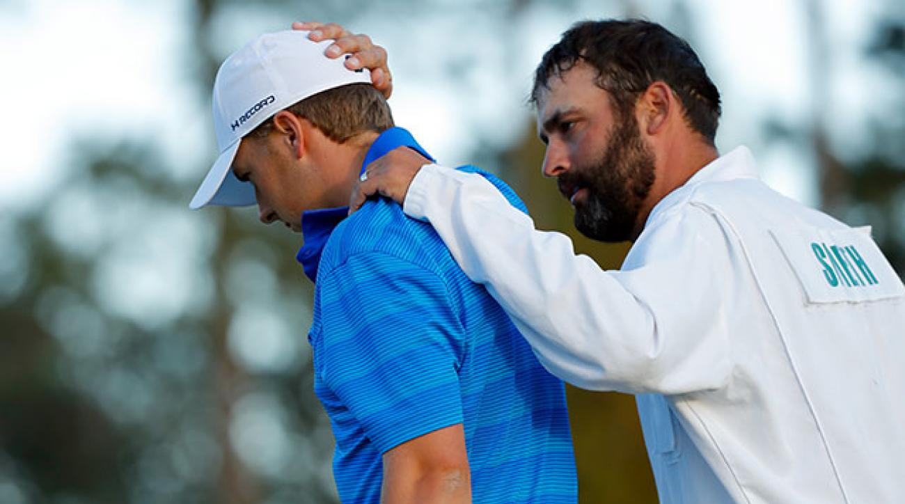 Caddie Michael Greller consoles Jordan Spieth after finishing their final round of the Masters.