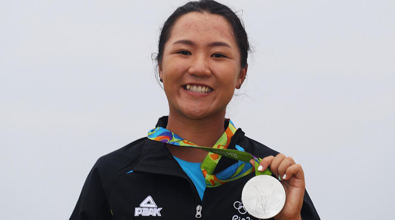 Silver medalist, Lydia Ko of New Zealand, poses on the podium during the medal ceremony for Women's Golf at the 2016 Rio Olympics.