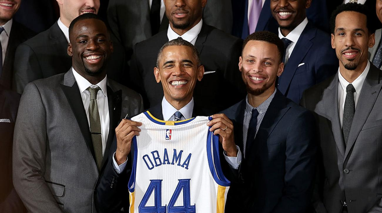 President Obama poses with Steph Curry and Draymond Green during their 2015 visit to the White House.