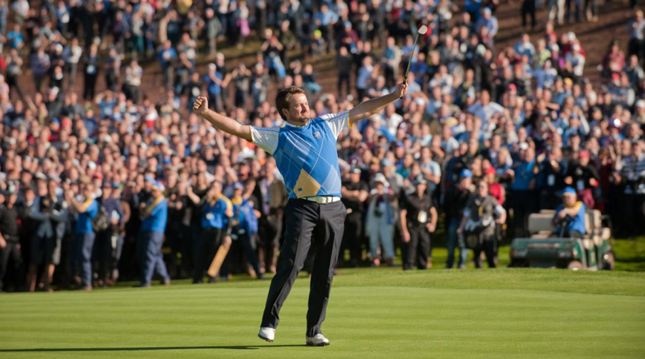 Graeme McDowell celebrates his Trophy-clinching putt at the 2010 Ryder Cup.