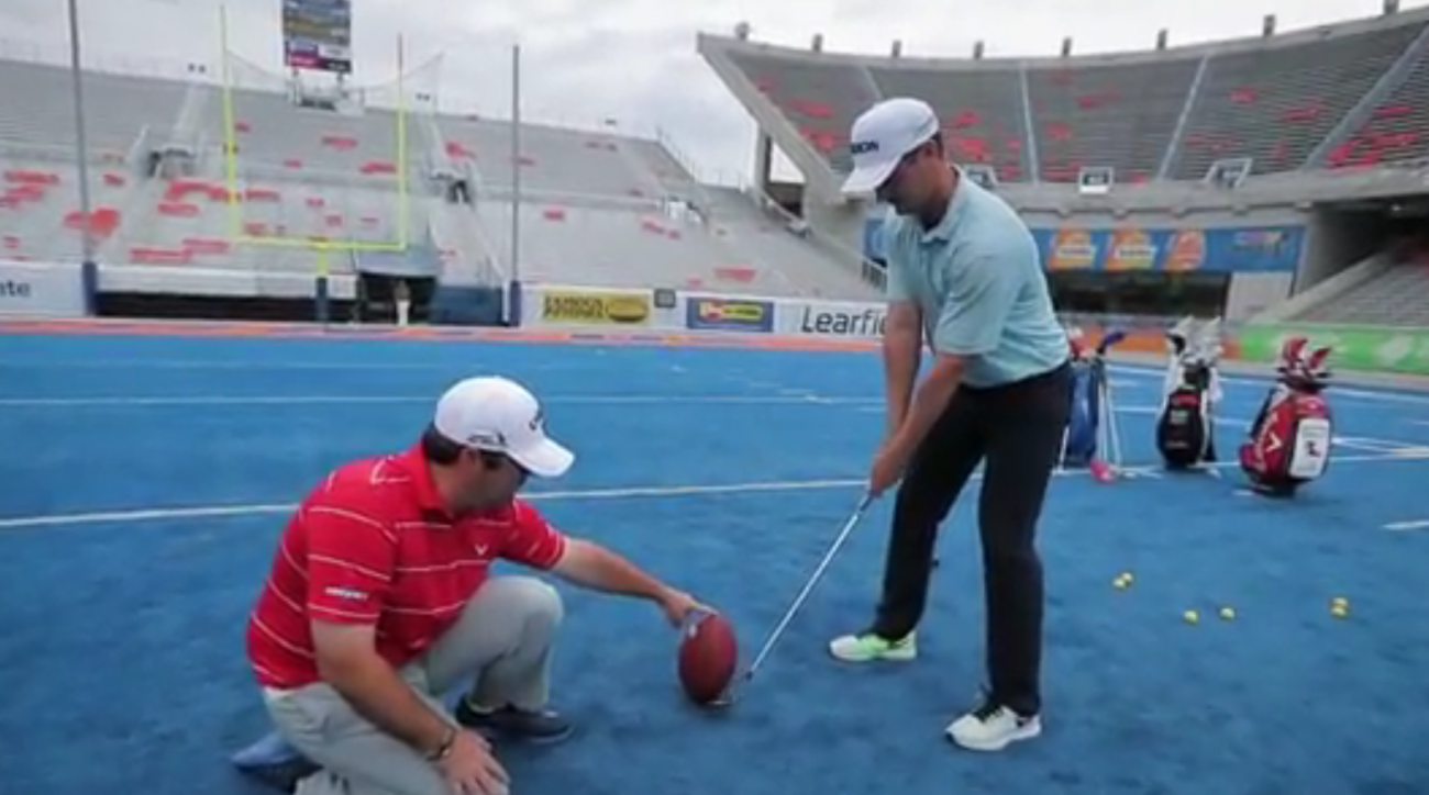 Rick Lamb attempts a 33-yard field goal with a golf club.
