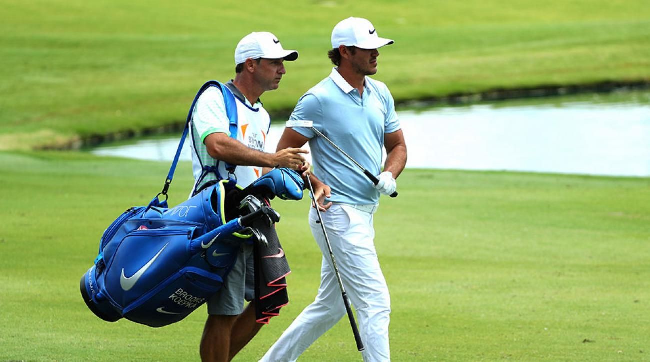 Ricky Elliott and Brooks Koepka walk together during the AT&T Byron Nelson Championship.