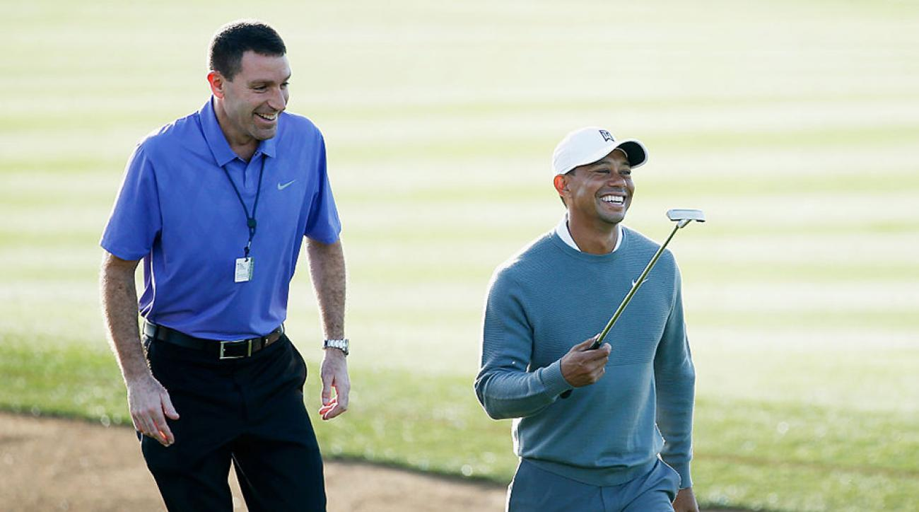 Tiger Woods and agent Mark Steinberg together in 2015 at the Waste Management Phoenix Open.
