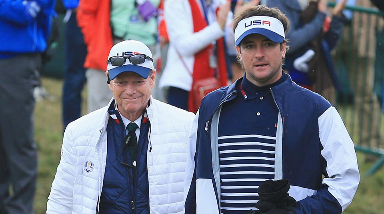United States team captain Tom Watson walks to the 1st tee with Bubba Watson during the Singles Matches of the 2014 Ryder Cup.