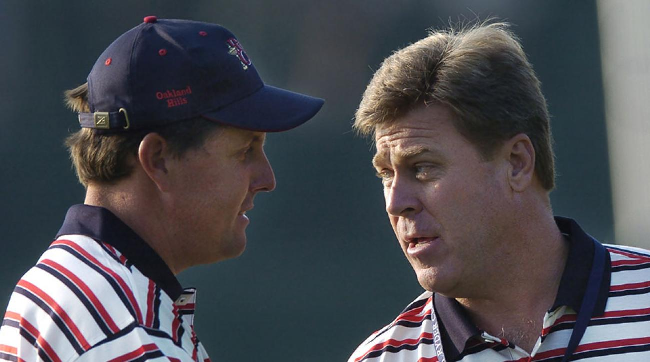 U.S. Team Captain Hal Sutton pumps up Phil Mickelson during Wednesday mornings practice session.