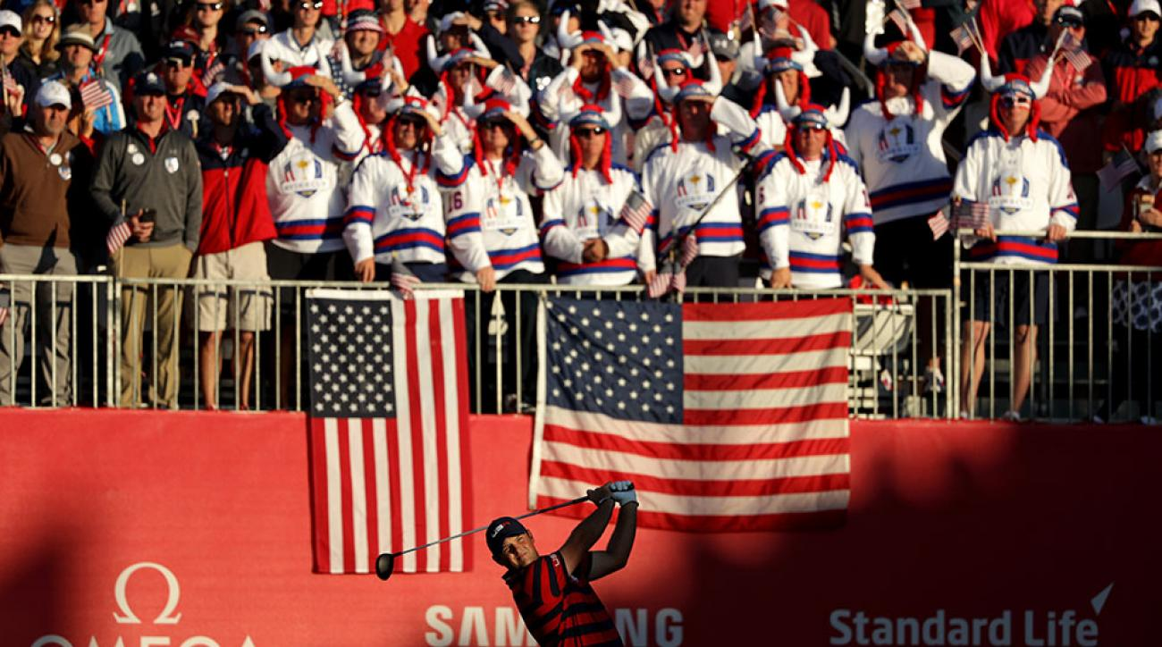 The red, white and blue grandstands while Patrick Reed tees off on the first hole.
