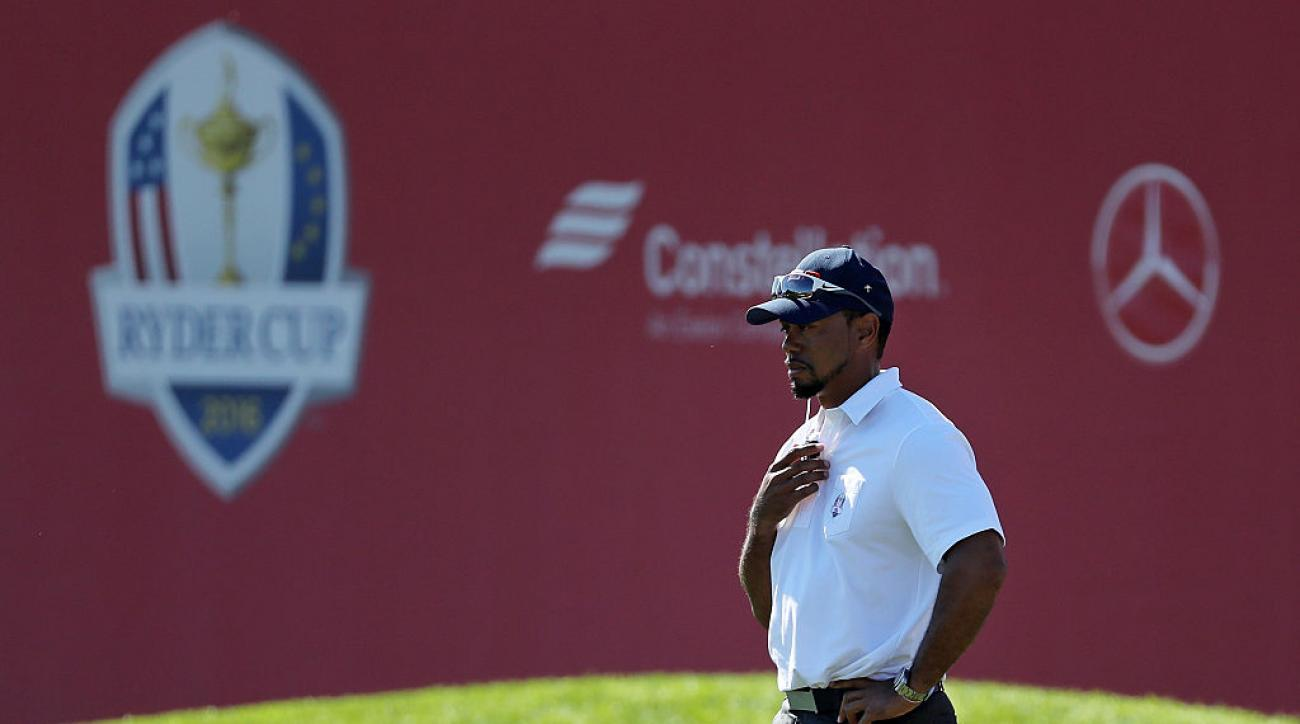 Vice-captain Tiger Woods looks on from the ninth hole during singles matches of the 2016 Ryder Cup.