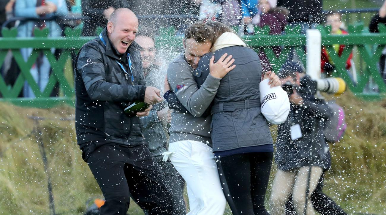 Tyrrell Hatton is showered by champagne on the 18th green after winning the Alfred Dunhill Links Championship at The Old Course on Oct. 9, 2016.