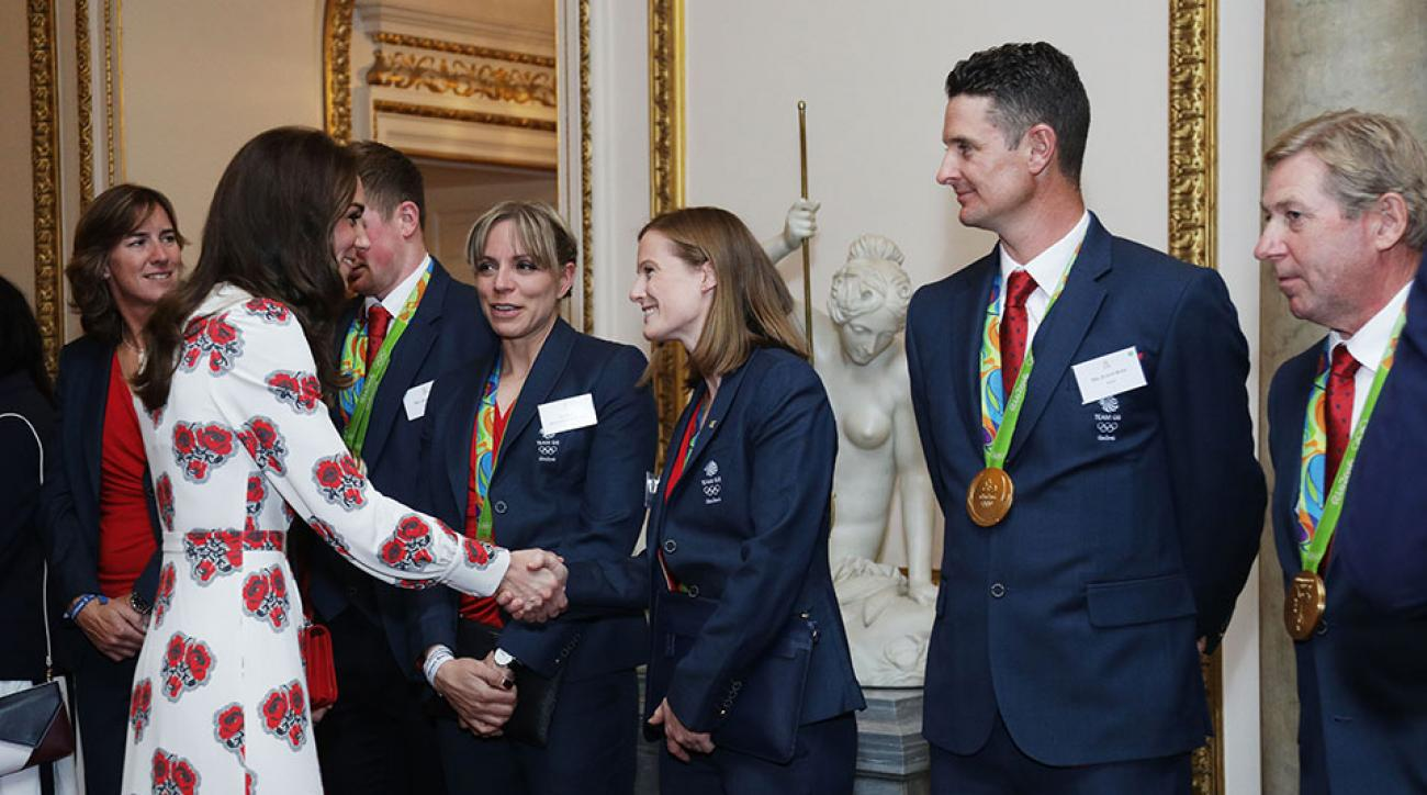 Britain's Catherine, Duchess of Cambridge, (2L) meets athletes including golfer Justin Rose (2R), an horse rider Nick Skelton (R) during a reception for Team GB's Olympic and Paralympic athletes, hosted by Britain's Queen Elizabeth II.