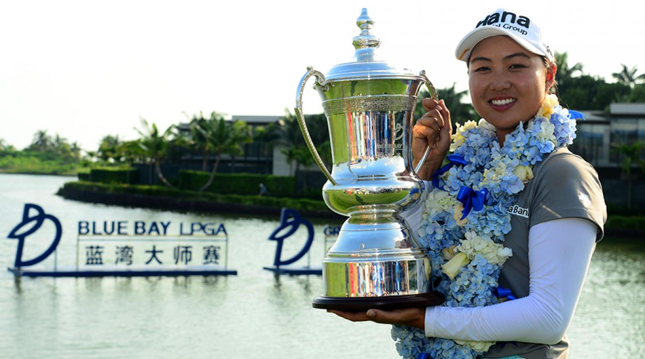Minjee Lee of Australia poses with her trophy after winning the Blue Bay LPGA tournament at Jian Lake Blue Bay Golf Course in Sanya, China.