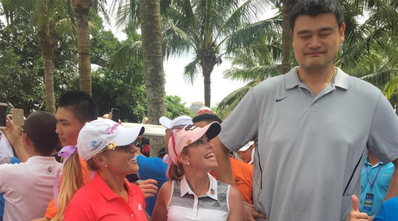 LPGA stars Natalie Gulbis and Paula Creamer pose with retired NBA star Yao Ming at the 2016 Mission Hills World Celebrity Pro-Am.