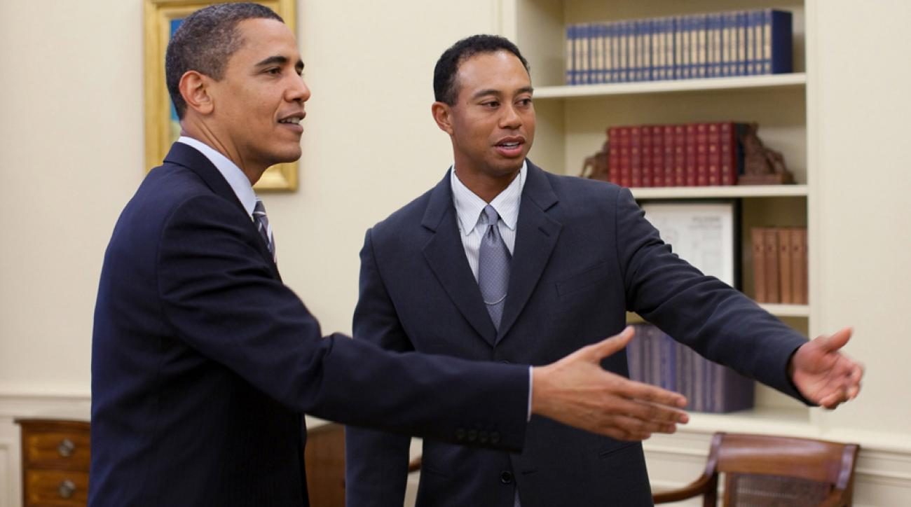 President Barack Obama talks with Tiger Woods in the Oval Office of the White House on April 20, 2009.