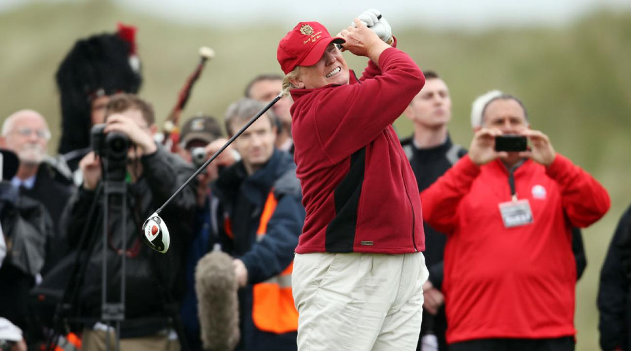 Donald Trump hits the first tee shot at Trump International Golf Links in Scotland in 2012.