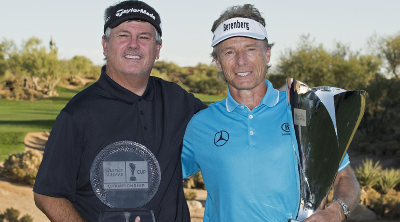 Paul Goydos poses with the tournament trophy and Bernhard Langer holds the Charles Schwab Cup on Sunday.