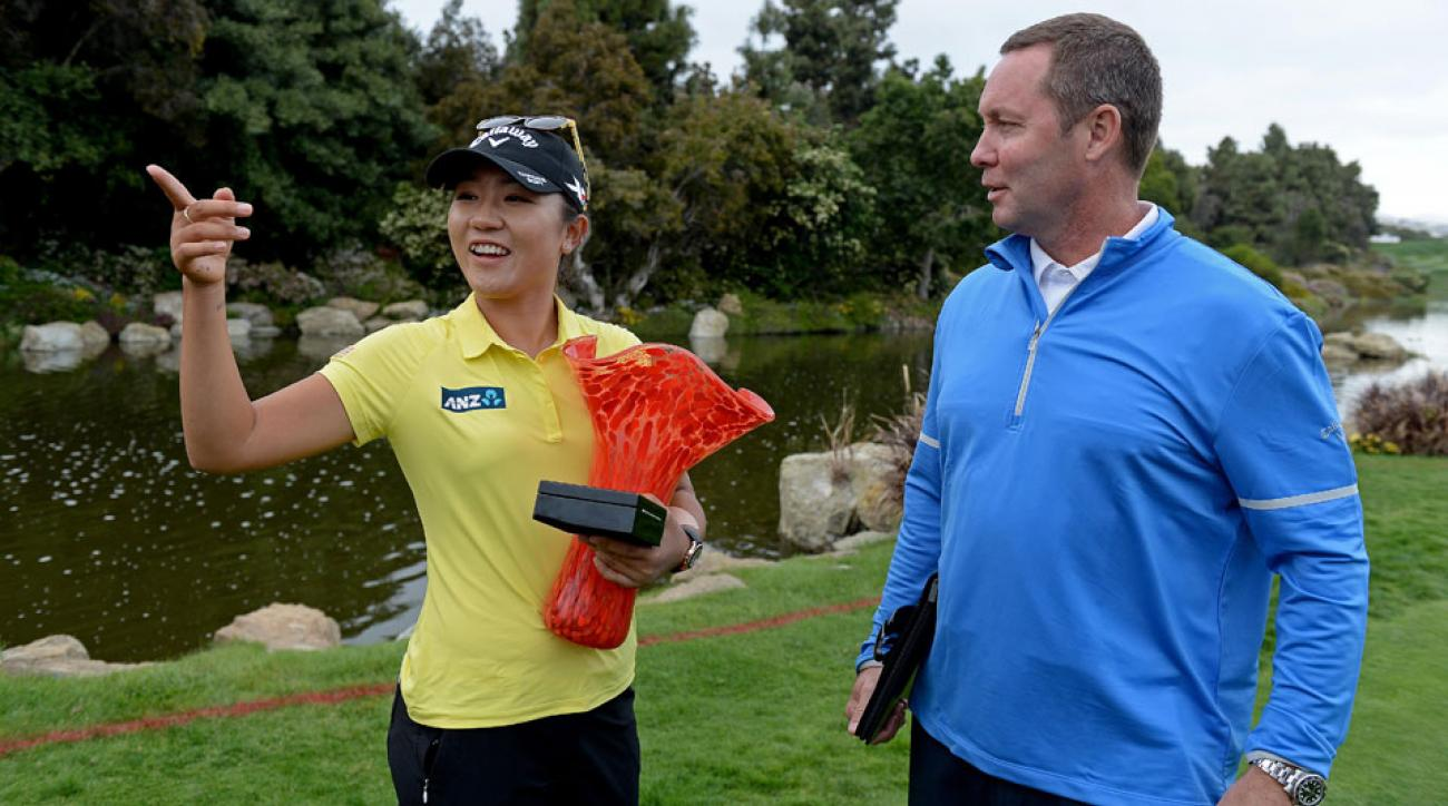 Lydia Ko of New Zealand speaks with LPGA Commissioner Michael Whan after winning the 2016 Kia Classic.