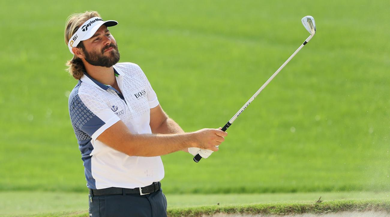 Victor Dubuisson hits his second shot on the 3rd hole during day three of the DP World Tour Championship at Jumeirah Golf Estates.