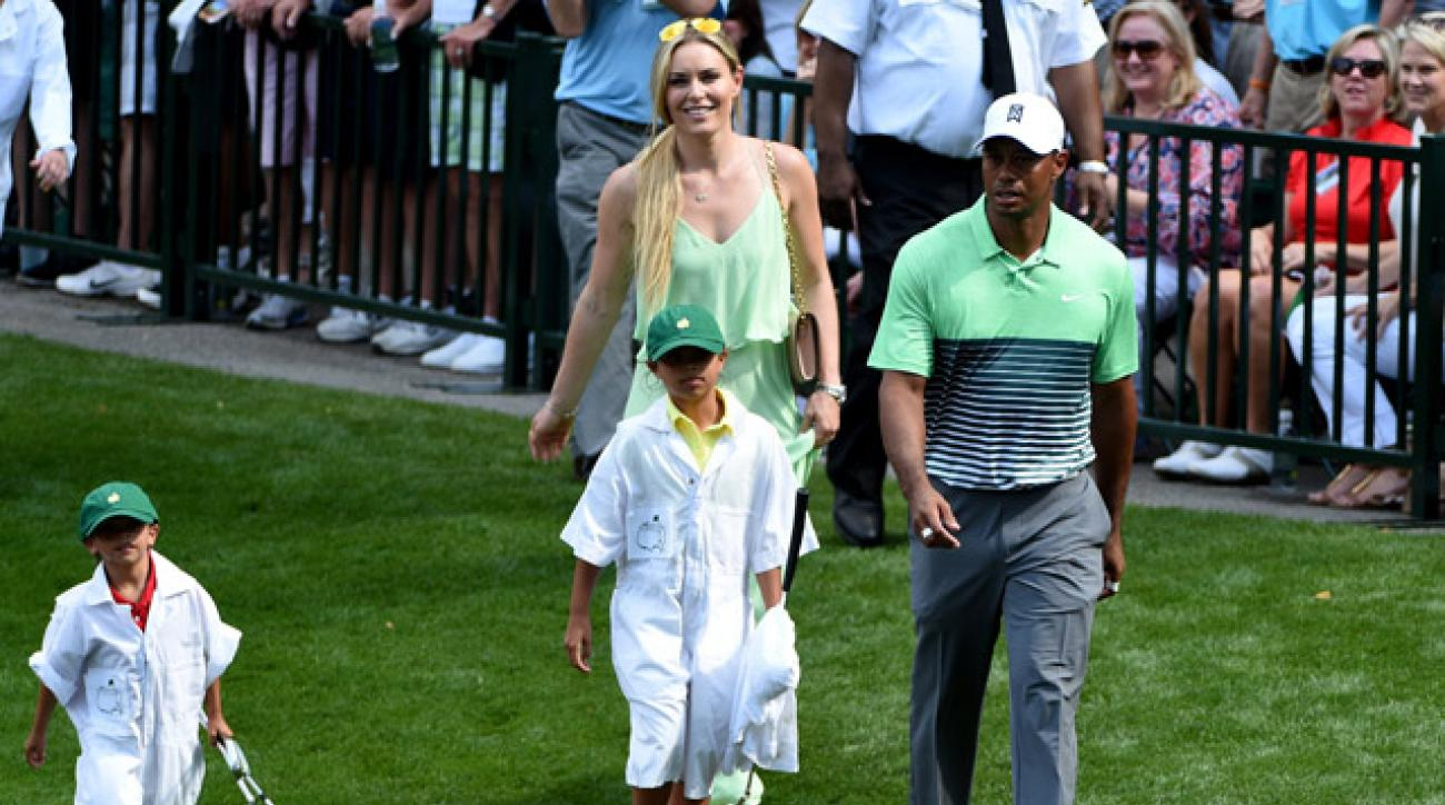 Tiger Woods walks with his son Charlie and daughter Sam during the par 3 contest prior to the start of the 2015 Masters Tournament