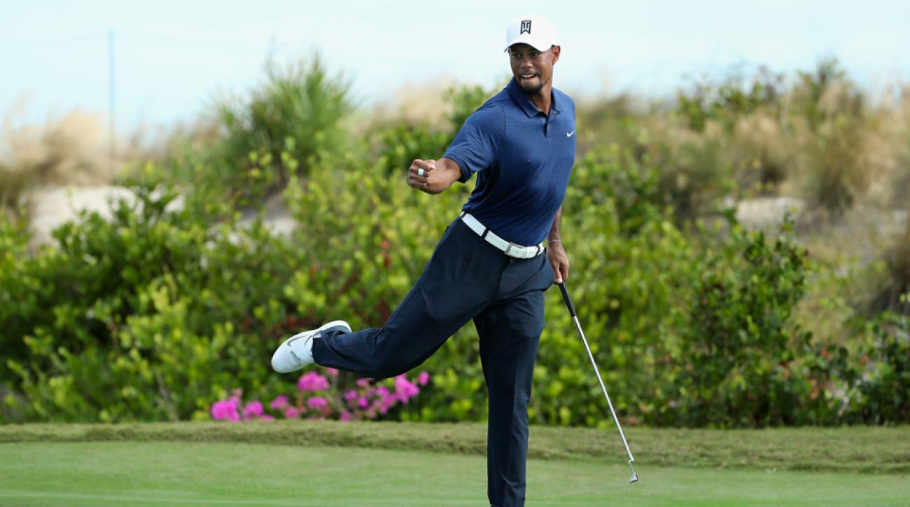 Tiger Woods reacts after saving par on the 16th hole at the Hero World Challenge Friday.