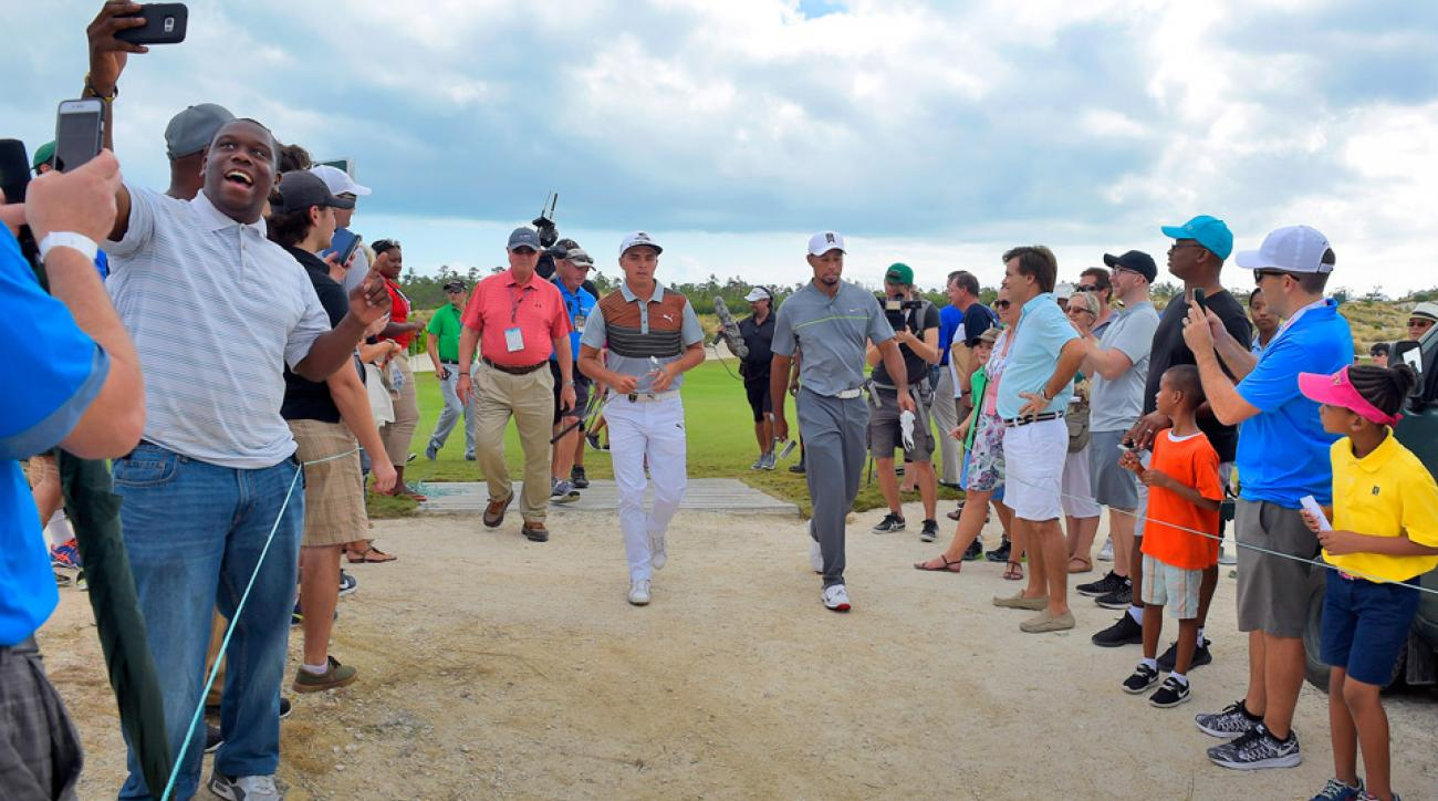 Tiger Woods walks with playing partner Rickie Fowler on Saturday at the Hero World Challenge.
