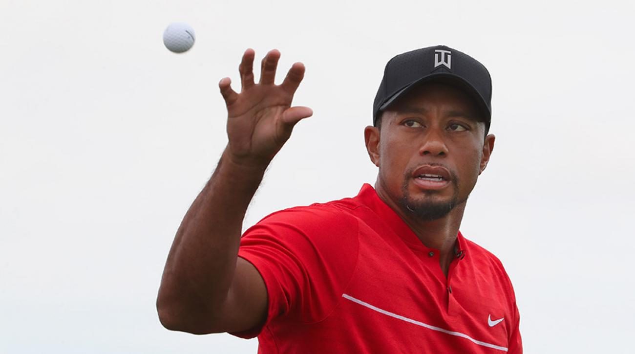 Tiger Woods catches a golf ball on the practice range during the final round of the 2016 Hero World Challenge at Albany, The Bahamas.