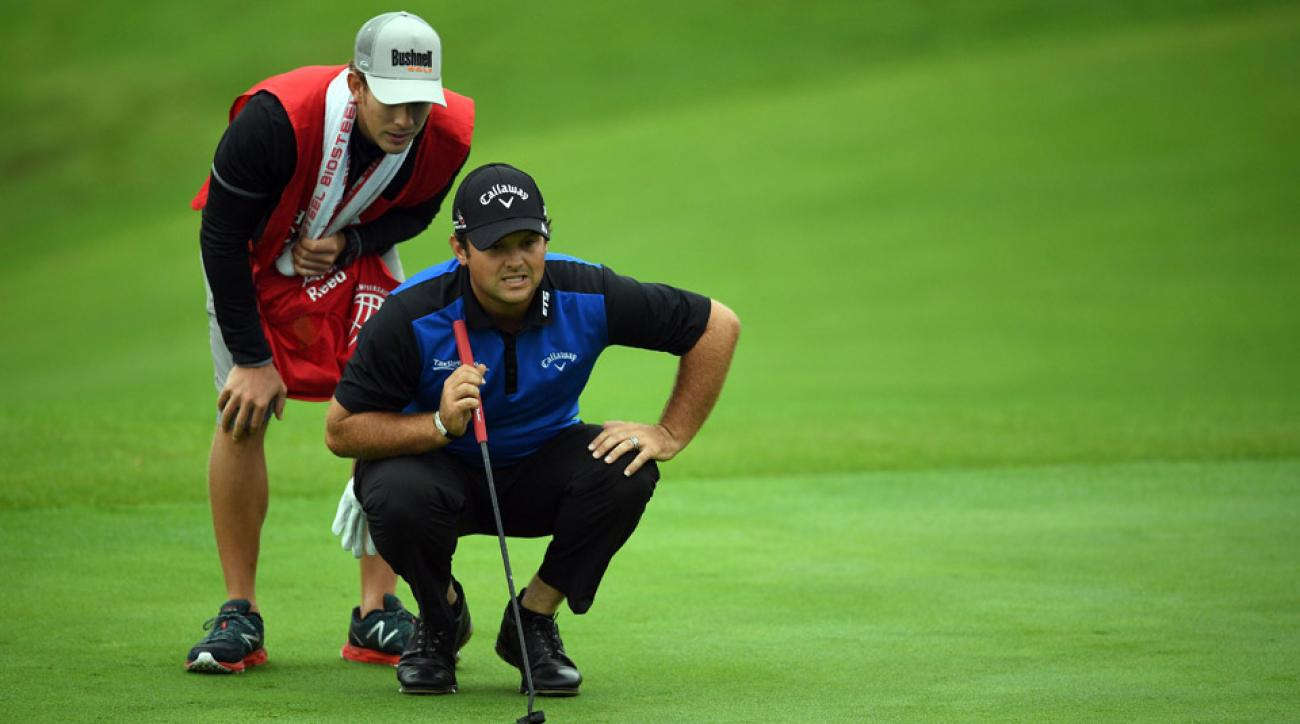 Patrick Reed lines up at putt at the World Golf Championships-HSBC Champions golf tournament in Shanghai on October 27, 2016.