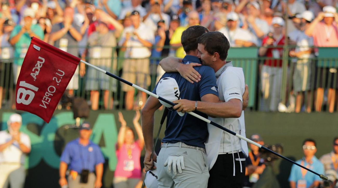 Dustin Johnson's first of many celebratory hugs was given to caddie and brother Austin Johnson.
