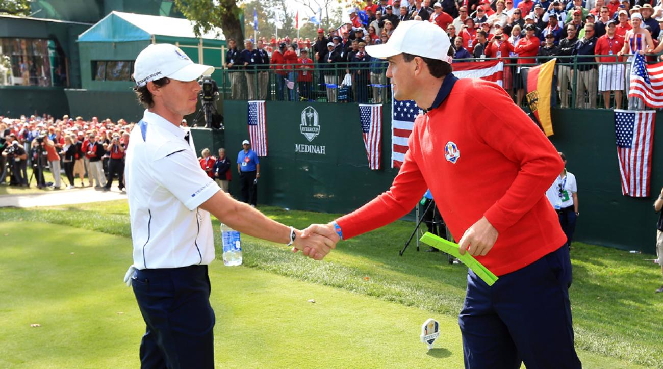 Rory McIlroy and Keegan Bradley shake hands prior to a match at the 2012 Ryder Cup.