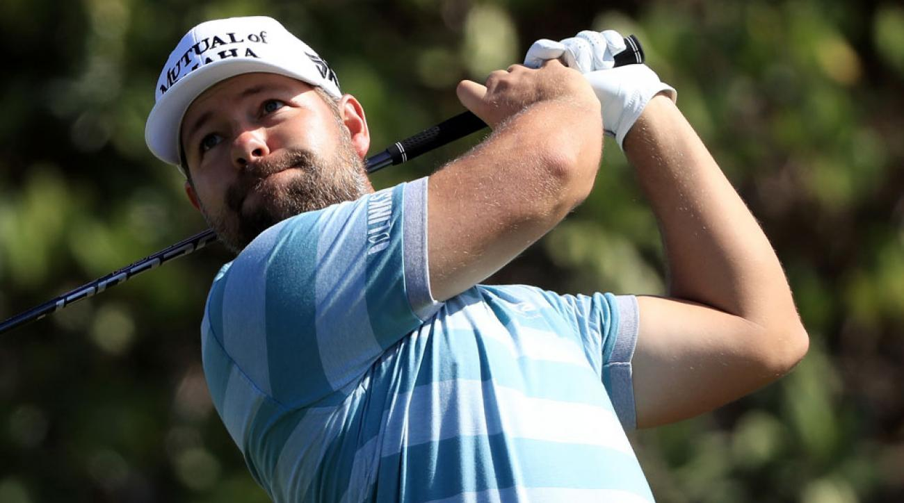 Ryan Moore opened with back-to-back 67s at Kapalua to grab a share of the 36-hole lead.
