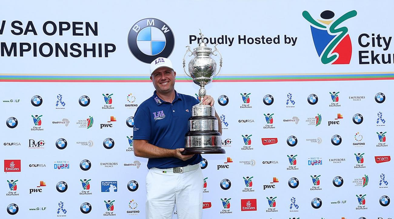 Graeme Storm of England celebrates with the trophy after winning the BMW South African Open Championship.